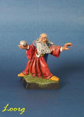Miniatura de Saruman con el palantir en la mano