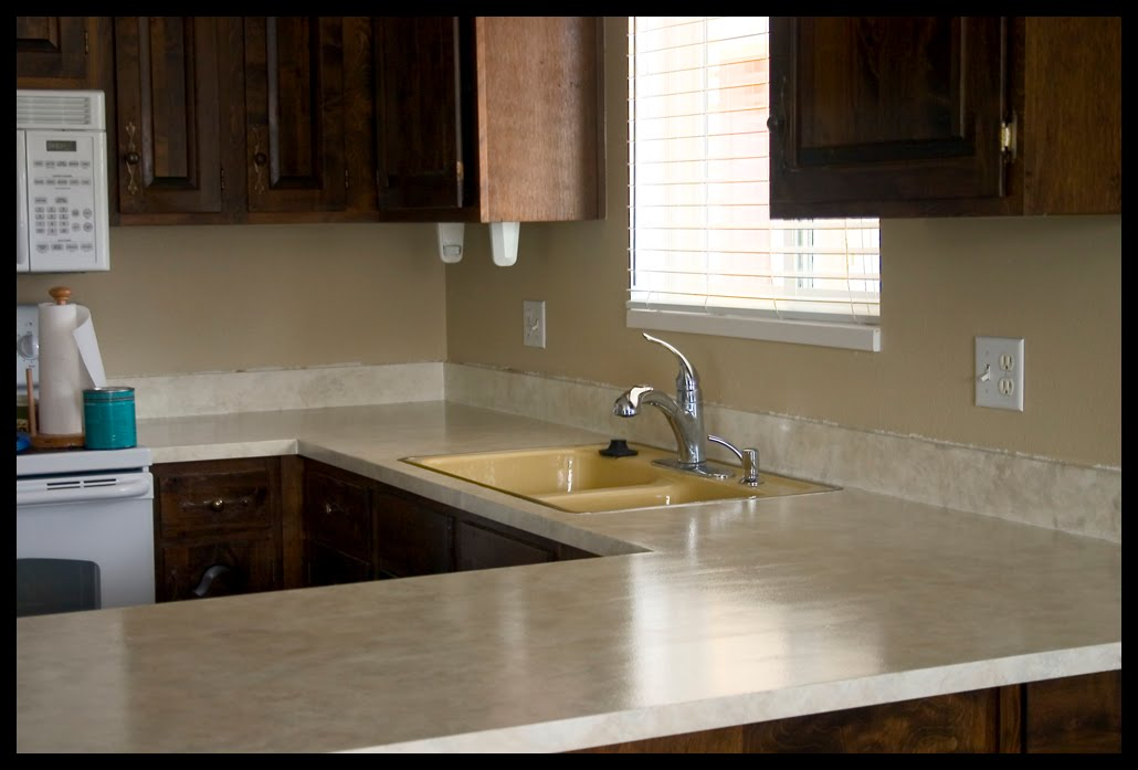 Painting your laminate countertops is a cheap, easy way to beautify your kitchen