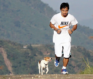 Manny Pacquiao running with a dog