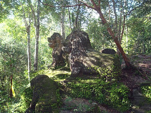 Two stone lions keeping guard at Srah Damrei on Phnom Kulen