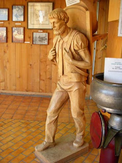 Cheese Statue of Man Carrying Cheese