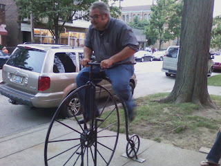 Nader Rides Bike outside of Edisons' Pub