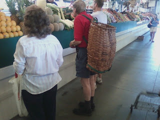 older gentleman with basket on back at West Side market