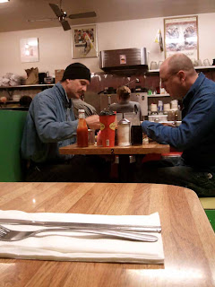 2 guys eating breakfast at Delucas