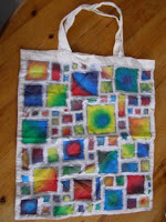 A cotton bag with colourful rectangles on it