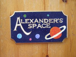 A plaque reading Alexander's Space