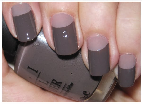 The moon manicure , which takes the typical French manicure, turns it