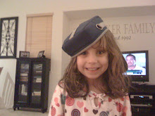 Katie With Her Leapster Cap
