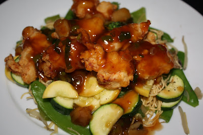 Hunan Style Chicken with Sauce over Chow Mein & Veggies