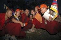 Tibetan monks listen to RFA