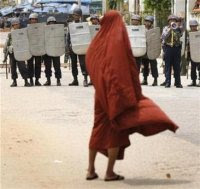 A monk faces riot police in Rangoon, Sept. 26, 2007