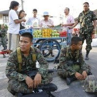 Fruit-sellers and soldiers