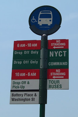 Bus stop sign. No Standing, 6 AM to 10 AM. NYCT: Drop-off Only. Command: Drop-off only. No Standing, 10 AM to 6 AM. Tour Buses: Drop-off & Pick-Up. Battery Place & Washington Street