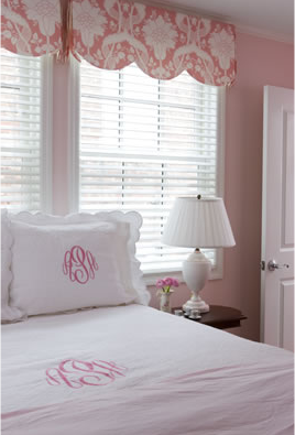 White and pale pink have been used in this bedroom to create a soft, calm and feminine look in this bedroom.