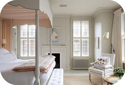 The calm pale colours of white and pink make this bedroom look very clean, calm and feminine.