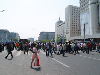 crowds crossing the street at Xidan