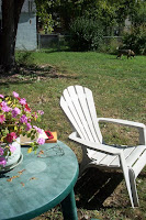 empty adirondack chair in the sun