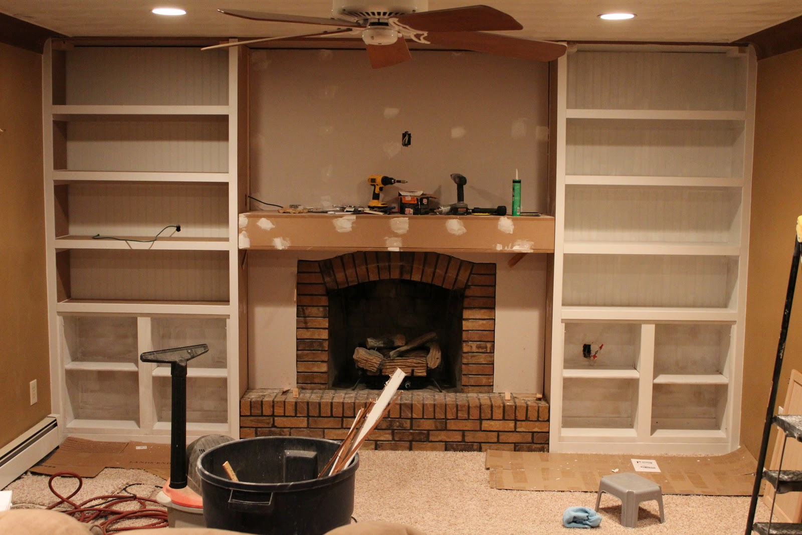 ... shelves. We also used dry wall to frame in the fireplace. The mantel