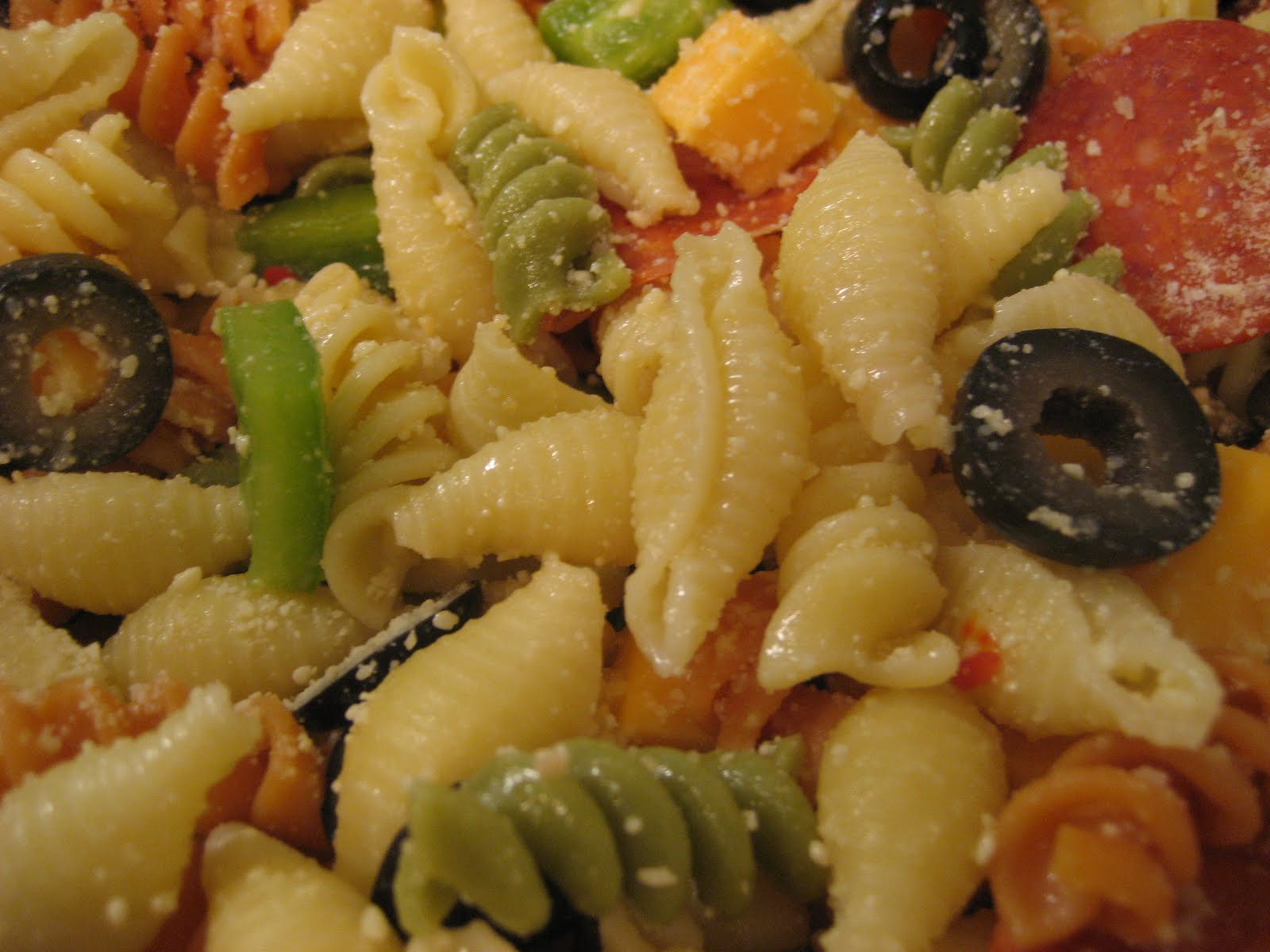 zesty italian Easy zesty italian pasta salad that is the perfect side dish to any meal customize this tri-colored pasta salad with your favorite veggies for a unique flavor.
