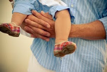 safe in Daddy's strong hands