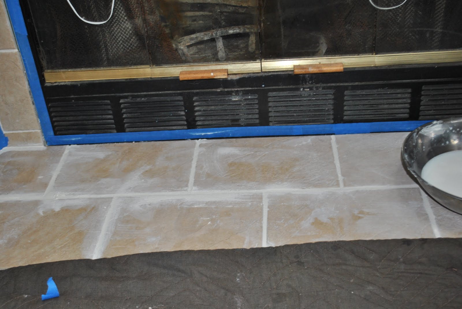 Diy fireplace surround transformation jenna burger remove the haze immediately if the tile starts to look like this wipe the haze with a damp cloth again then buff the tiles with a clean dry cloth dailygadgetfo Gallery