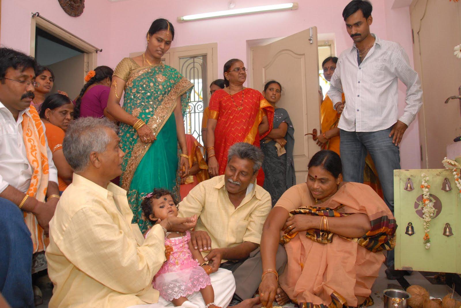 Charvitha gogineni grand parents and mama for Annaprasana decoration
