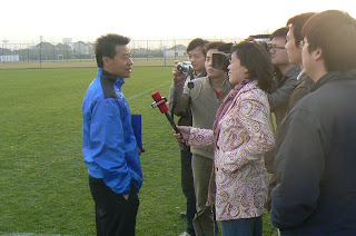 Wu Jingui talking to reporters at Shanghai Shenhua's training ground