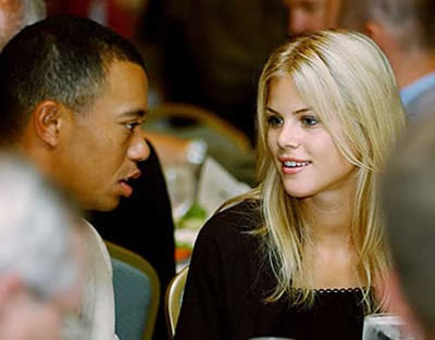 Tiger Woods talking with girlfriend