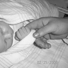 Madi holding Evan's hand