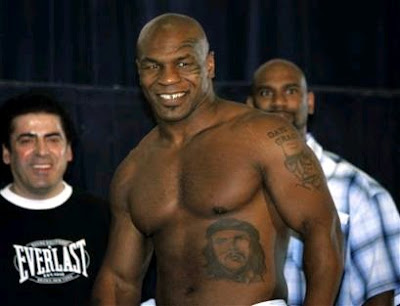 Checkout these pictures of boxing great Mike Tyson and his tattoos.