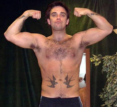 More tattoo information: Robbie Williams Tattoos