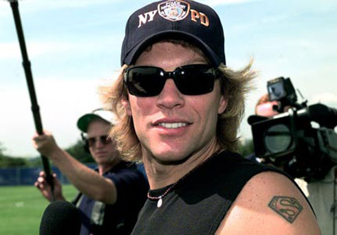 jon bon jovi with superman tattoo on arm