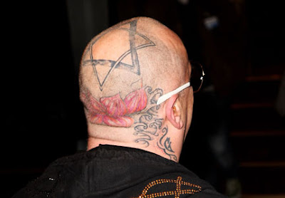Boy George Star Tattoos On His Head
