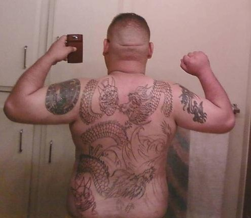 Ah yes, we have yet another back piece tattoo of poor quality,
