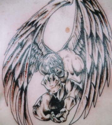 Scary fallen angel tattoo.