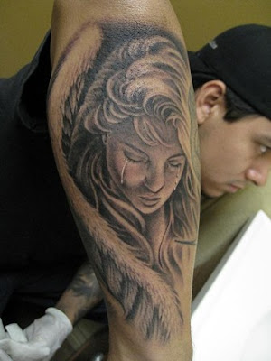 Crying angel tattoo on forearm