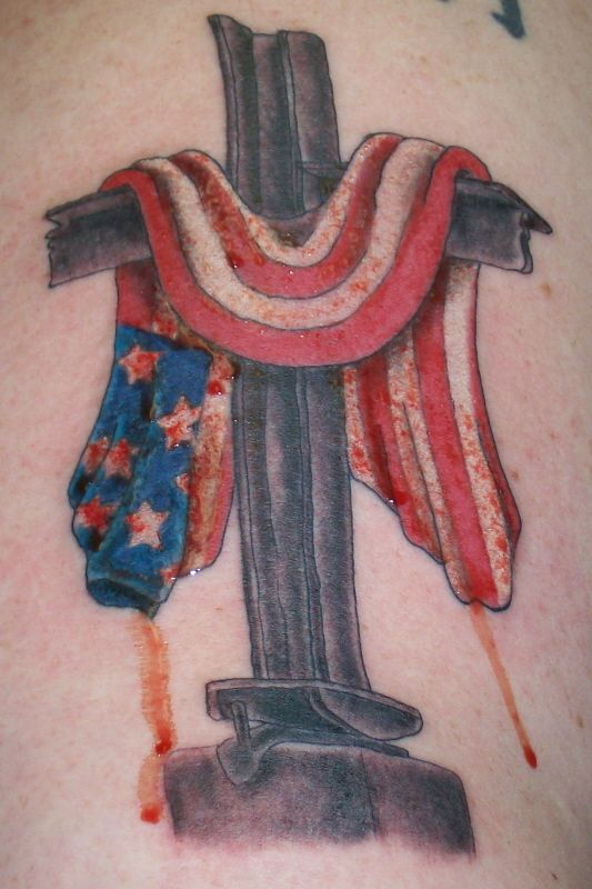 USA flag and cross tattoo.