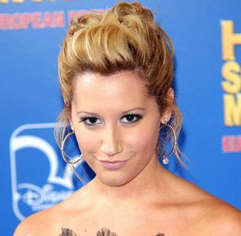 Ashley Tisdale loose fitting updo hairstyle.