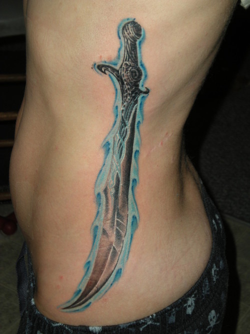 Large sword on side tattoo.