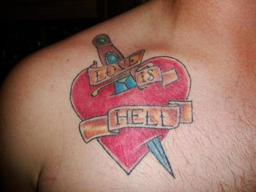 Heart and dagger tattoo on chest.