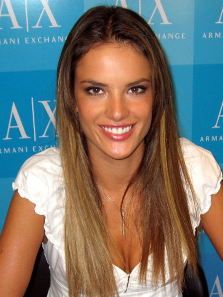 Sleek straight long hairstyle with dark roots.