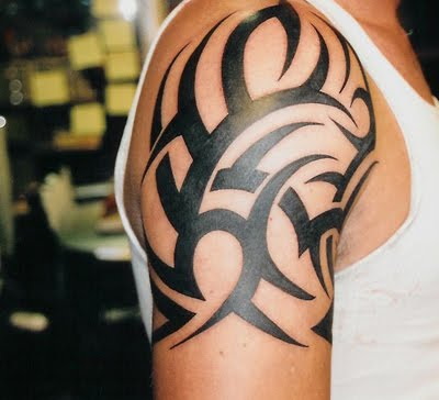 Dark bold tribal shoulder tattoo.