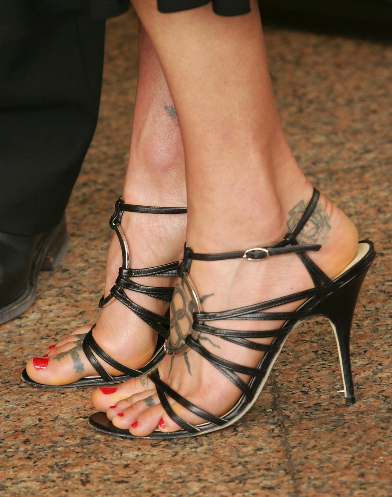Checkout Some Nice Pictures Of Her Feet, Legs And Toes