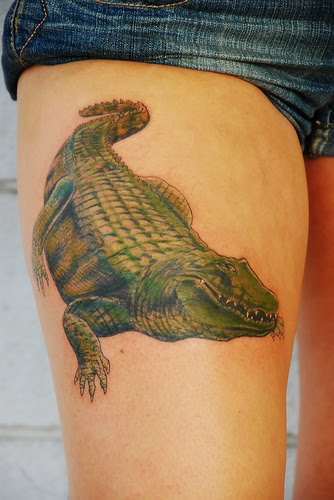 Big Alligator tattoo on thigh.
