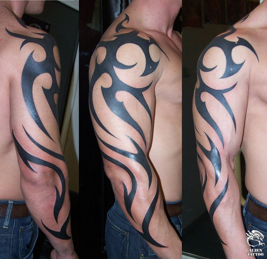 Large tribal arm tattoo.