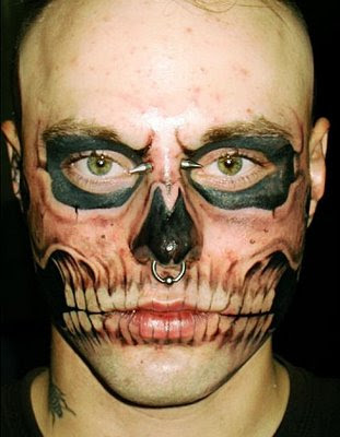 Skull face tattoo.