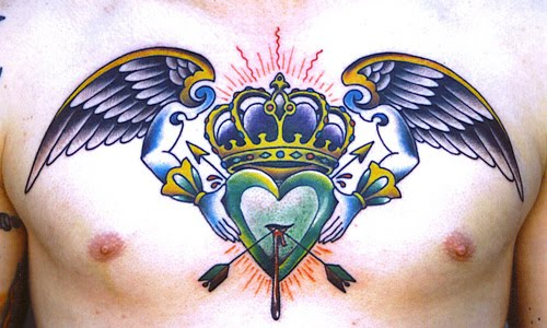 Heart crown and wings chest tattoo design.