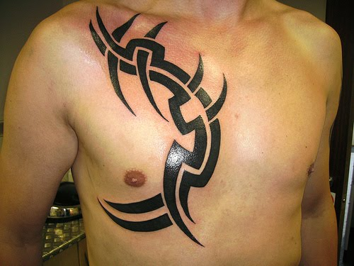 Tribal chest tattoo for men.