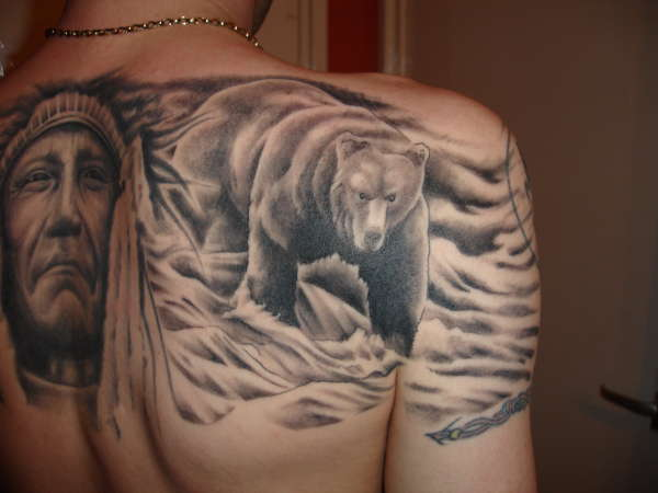 Adding a little color to your bear tattoo can really bring the design