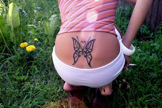 Lower Back Butterfly Tribal Tattoos Picture 2